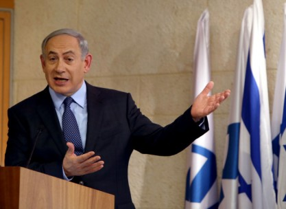 Israeli Prime Minister Benjamin Netanyahu gestures as he speaks on October 15, 2015, during a press conference at the foreign ministry in Jerusalem. Netanyahu reiterated his willingness to meet Palestinian leader Mahmud Abbas, while accusing him of inciting and encouraging violence, after a wave of Palestinian attacks that have shaken the country. AFP PHOTO / GALI TIBBON