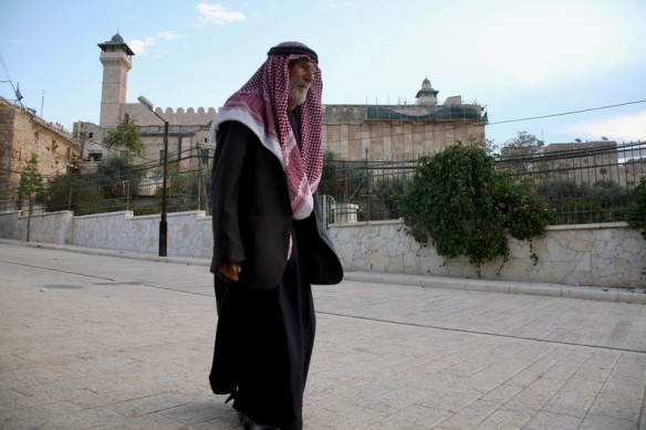 A Palestinian man walks near the Ibrahimi mosque  during a special prayer on the first day of Eid al-Adha in the West Bank city of Hebron