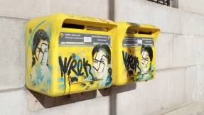 TOPSHOT - A photo taken on February 11, 2019 in the 13th arrondissement of Paris, shows Anti-Semitic graffiti written on letter boxes displaying a portrait of late French politician and Holocaust survivor Simone Veil. / AFP / JACQUES DEMARTHON