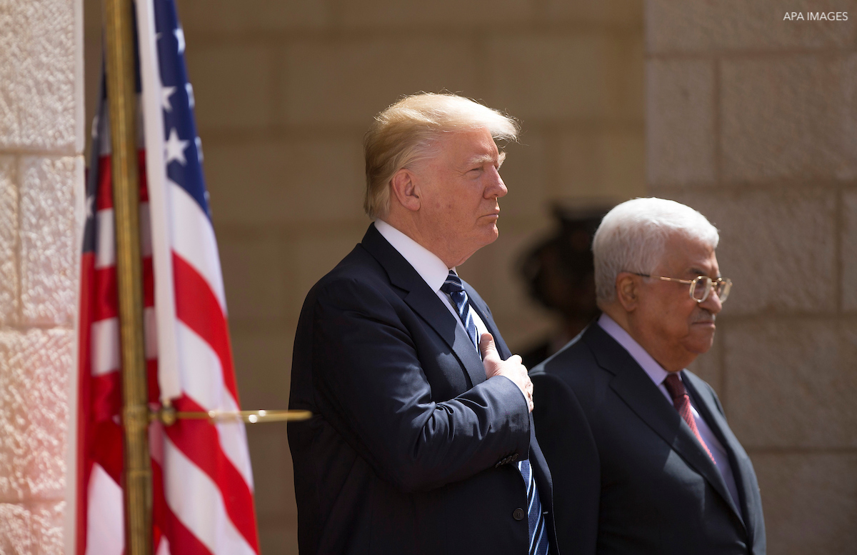 U.S. President Donald Trump and Palestinian President Mahmoud Abbas review the honor guard during a reception ceremony at the presidential headquarters